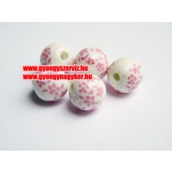 Porcelán gyöngy 10mm. Rózsaszín apró virág.