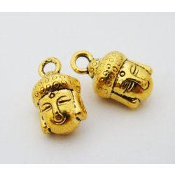 Fém medál, buddha fej. 9x14mm. Antik arany szín.