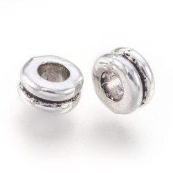 Köztes fémgyöngy. Gyűrű. 5x4mm. Antik ezüst szín.