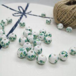 Porcelán gyöngy. 6mm. Zöld virágok. Mindig akcióban!