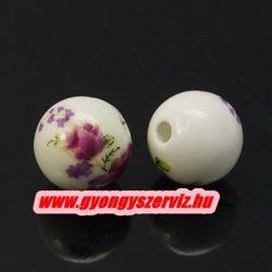 Porcelán ékszergyöngy. 12mm. Lilás virág.