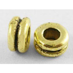 Köztes fémgyöngy. Gyűrű. 5x4mm. Antik arany szín.