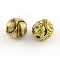 Golyó. 9.5x9.5x8mm. Yin-yang. Antik arany szín. Fémgyöngy, köztes gyöngy.