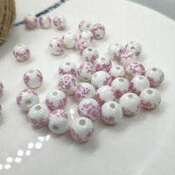 Porcelán gyöngy. 6mm. Rózsaszín virágok. Mindig akcióban!