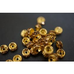 Rondell. Strasszos köztes gyöngy, rondella. 6mm. Arany-pezsgő.